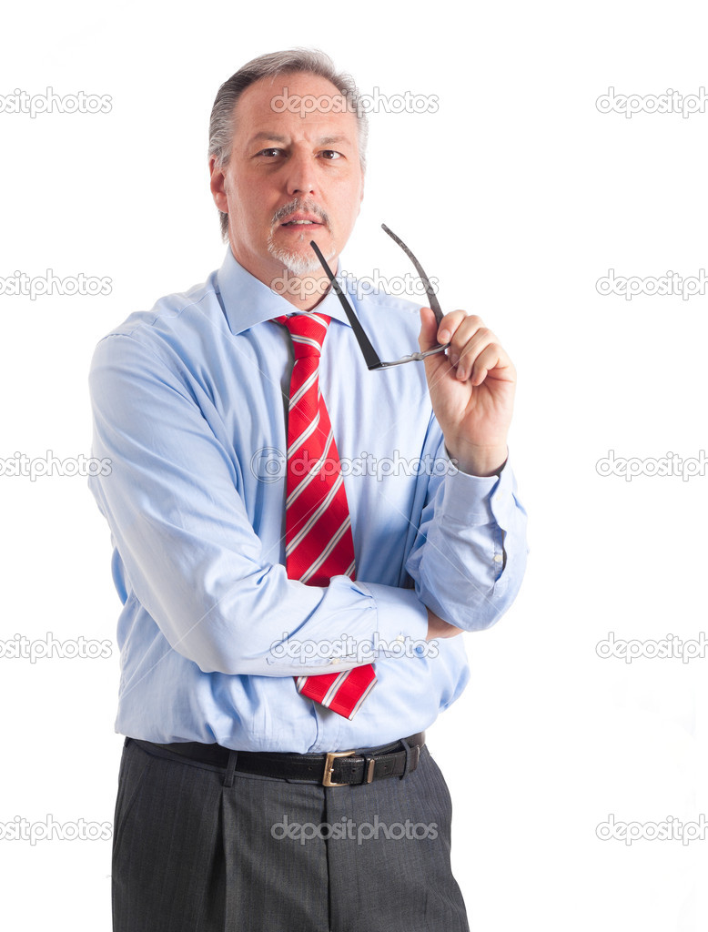 Portrait of a senior consultant holding his glasses while explaining something — Stock Photo #6484091