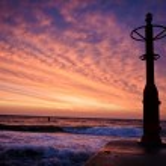 Latern on groyne with sunset baltic sea — Stock Photo