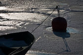 Freezed boat in dock with buoy — Stock Photo