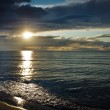 Reflection on sea at sunset over dynamic sky — Stock Photo #6460508