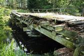 Old vintage bridge over the river — Stock Photo
