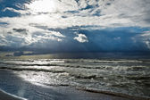 Storm over baltic sea with sunbeam — Stock Photo