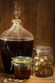 Homemade wine in basement with honey — Stock Photo