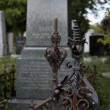 Metal detail on a grave - Stock Photo