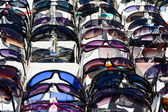 Fake sunglasses on a flea market — Stock Photo