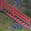 Bicycle parked below the stairs — Stock Photo