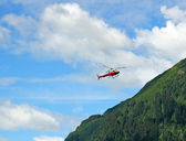 Red helicopter on a rescue mission — Stock Photo