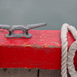 Cleat on the dock of the boat harbor with rope - Stock Photo