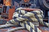 Bollard with rope on the deck of an old ship — Stock Photo