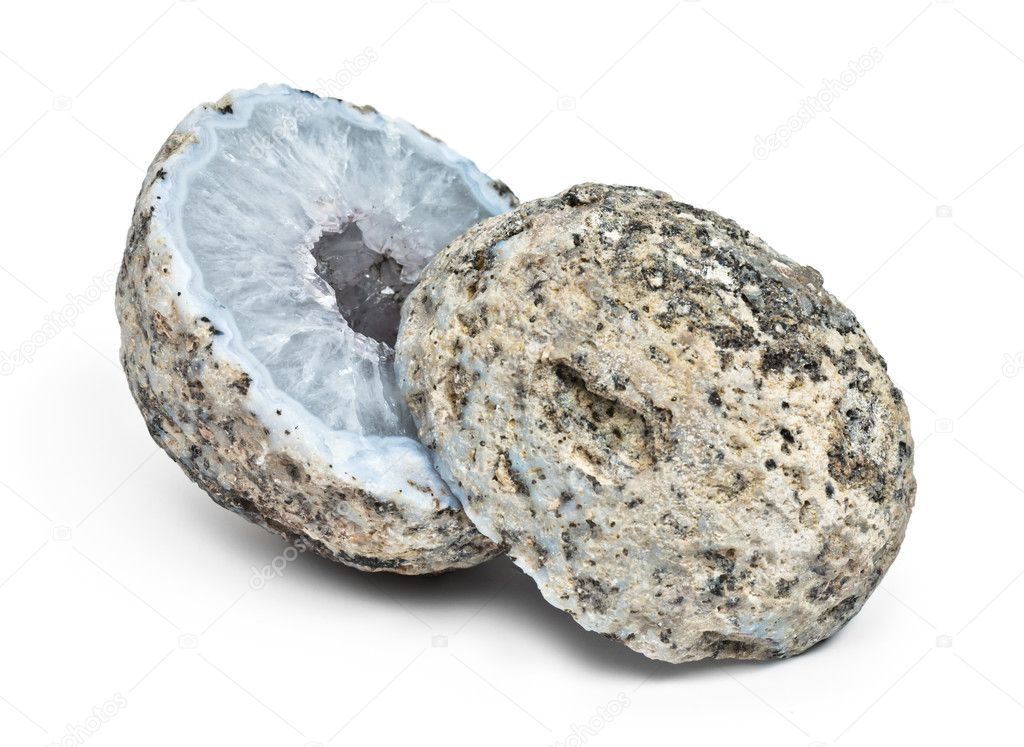 Crystal geode divided in two parts  with white quartz crystals inside isolated  Stockfoto #6452970