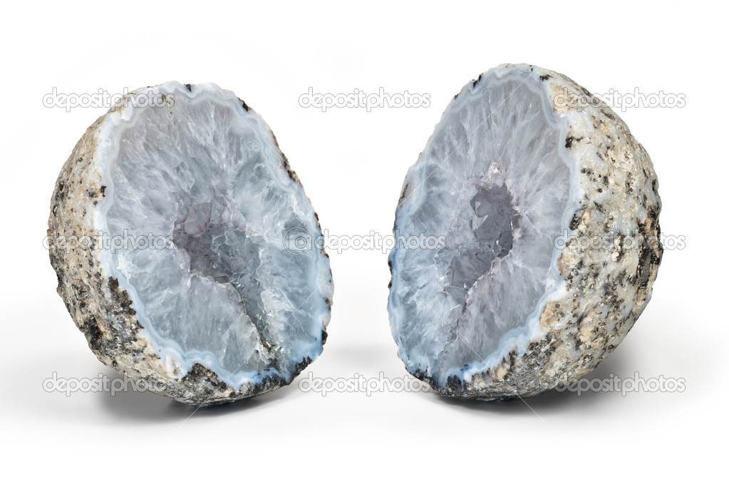 Crystal geode  with white quartz crystals inside divided in two parts isolated — Stock fotografie #6453179