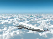 Airplane in the sky - Passenger aircraft in flight over the clouds side rear view — Foto Stock