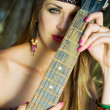 Stock Photo: Hippie girl with a guitar
