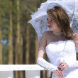 Making look younger bride with umbrella — Stock Photo #6632473