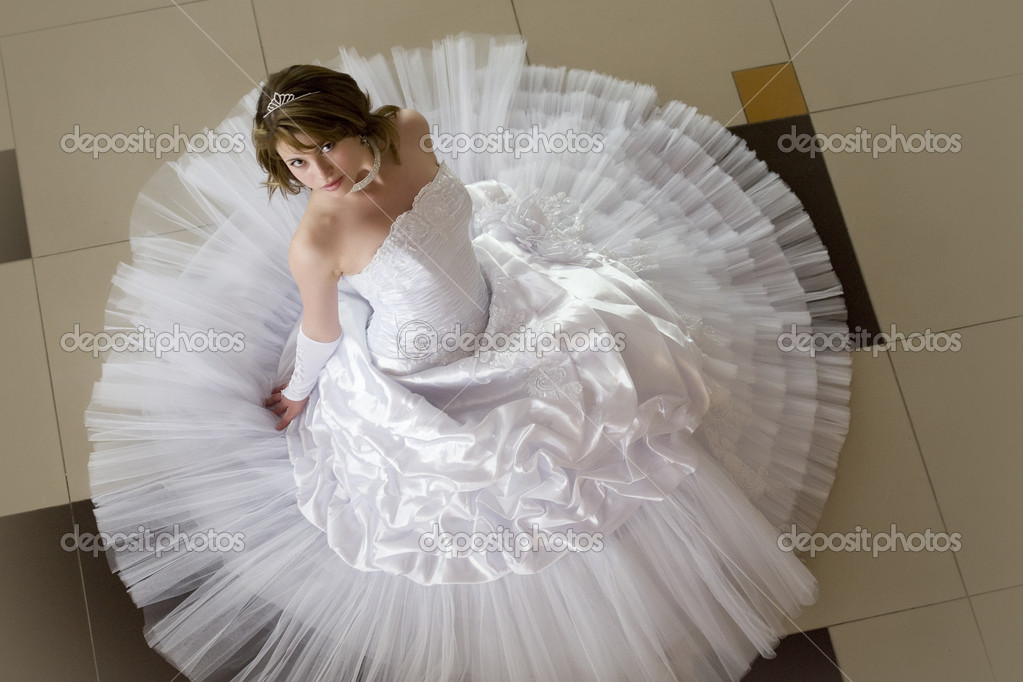 Young woman in a wedding dress  Stock Photo #6663260