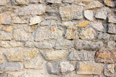 Wall of stones and cement — Stock Photo