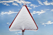 A red sign warns of snow — Stock Photo