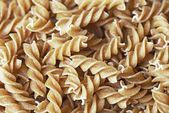 Raw organic italian pasta — Stock Photo