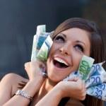 Beautiful joyful girl with Euro bills — Stock Photo #6444879