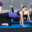A small group of young women doing butt exercises — Stock Photo