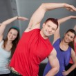 A group of young stretching at a health club — Stock Photo