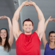 Royalty-Free Stock Photo: A group of young in aerobics class