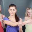 Three beautiful young woman doing aerobics exercises — Stock Photo
