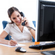 Young business woman taking notes over the phone — Stock Photo