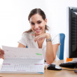 Gorgeous young businesswoman behind her desk. — Stock Photo