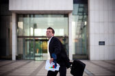 Fired businessman about to throw his briefcase — Stock Photo