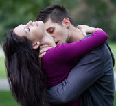 Young man passionately kissing his girlfriend on the neck — Stock Photo
