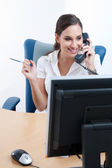 Young businesswoman talking on the phone — Stock Photo