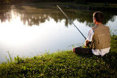Man fishing in a pond — Stock Photo