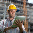 Construction specialist using a tablet computer - Stok fotoraf