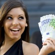Beautiful young woman with a handful of Euro bills. — Stock Photo