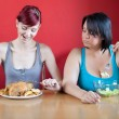 Tailored diet. Skinny woman is happy because she can eat huge me — 图库照片