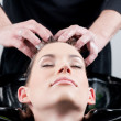 Hair massage/hair wash in a hair-salon — Stock Photo