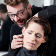 Mad hairdresser about to cut off his client's ear — Photo