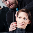 Mad hairdresser about to cut off his client's ear — Stock Photo
