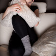 Beautiful young woman watching a horror movie alone — Stock Photo #6604503