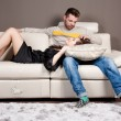 A couple in love on the sofa — 图库照片