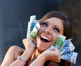 Beautiful joyful girl with Euro bills — Stock Photo