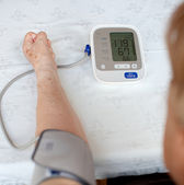 Senior woman measuring her blood pressure. At home. — Stock Photo