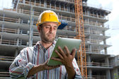 Construction specialist using a tablet computer — Foto de Stock