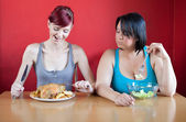 Tailored diet. Skinny woman is happy because she can eat huge me — Stock Photo