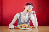 Skinny woman with a whole chicken on her plate stuffing herself — Stock Photo