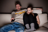 Man in a bad mood because there's nothing interesting on TV — Stockfoto