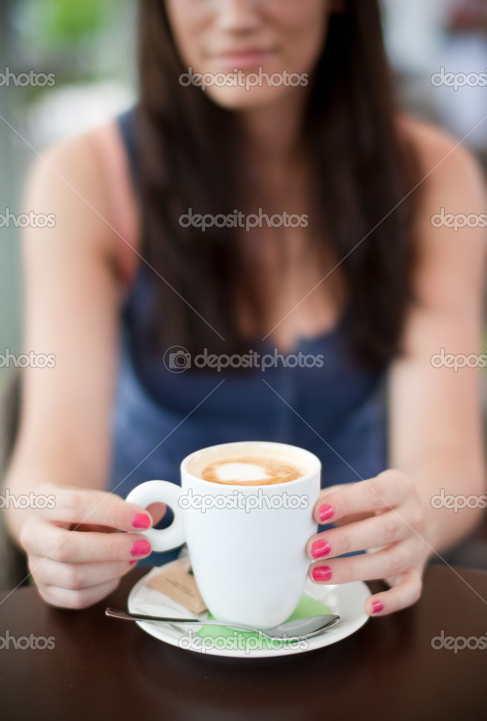 Selective focus on the coffee cup.   Stock Photo #6600032