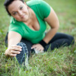 Happy overweight woman stretching in a park — Stock Photo #6642894