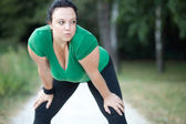 Overweight woman exhausted after a long run. Selective focus. — Stock Photo